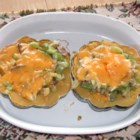 Cheesy Acorn Squash - Baked acorn squash filled with a saute of celery, onions and mushrooms, and topped with cheese.