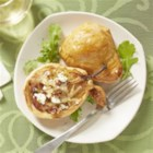 Perfect Pair Pear Puffs - Pear halves, encased in puff pastry with a broiled cheese and pecan filling, perform beautifully as either appetizer or dessert.