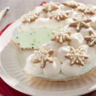 Peppermint Snowflake Ice Cream Pie - Pastry snowflakes and drifts of whipped topping adorn a frosty peppermint ice cream pie.