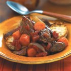 Tuscan Beef Stew - This slow-simmered beef stew with chunks of carrots, diced tomatoes and cannellini beans captures the rich flavors of Tuscany.