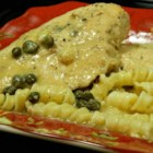 Arica's Chicken Piccata - This Italian-style chicken recipe calls for chicken breasts to cook in a sauce of white wine, chicken broth, capers, and Parmesan cheese for a tasty main course.