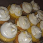 Lemon-Filled Cupcakes - Light and luscious lemony cupcakes have a lemon filling and a rich white chocolate cream cheese frosting.