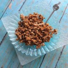 Cinnamon Maple Granola with Coconut - Oats and coconut flakes are baked in a mixture of honey, maple sugar, maple syrup, vanilla, and, of course, cinnamon, for a quick and easy homemade granola.