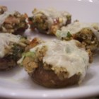 Dinah's Stuffed Mushrooms - Delicious mushroom caps filled with a clam stuffing! Very easy, and even better than the stuffed mushrooms from that famous Italian restaurant chain.... Garnish with lemon wedges when serving.