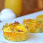 Bird's Nest Breakfast Cups - Fun bird nests made from baked hash brown potatoes enclose beaten egg, bacon, and cheese for a recipe that's perfect for an Easter brunch or a tasty grab-and-go breakfast.