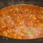 Slow-Cooked Chili - Here's a hearty chili made with ground beef and kidney beans, cooked for hours in a slow cooker.