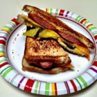 Frankly Super Supper - Generously buttered sourdough bread slices are layered with a hot dog, sharp Cheddar cheese, and pickles and are pan-fried for a 'frankly' super sandwich.