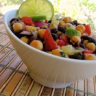 Summery Bean Salad - This refreshing bean salad uses black beans and garbanzo beans, and is the perfect addition to a picnic table!