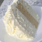 White Almond Wedding Cake - Start with a white cake mix, and add sour cream and almond flavoring to make a quick, moist cake that's ready for your decorating touches.
