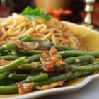 Green Beans With Shallot Dressing - Lightly-steamed, slender green beans get a kick from a fresh vinaigrette dressing made with bacon and shallots.