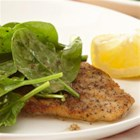 Basil Chicken Milanese - Crisp pan-fried chicken cutlets are served over spinach salad drizzled with a lemony dressing.
