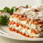 Lasagna Formaggio - Ricotta, mozzarella and Parmesan cheeses seasoned with Italian herbs are layered with pasta and marinara sauce.