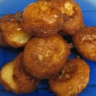 Sfingi - A sweet batter made from ricotta cheese is deep fried and drizzled with honey and sprinkled with confectioners' sugar.  Also called zeppole.