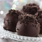 OREO Cookie Balls - Can't decide between cookies and confections? You don't have to! These chocolate-covered cookie balls feature a filling of cream cheese and crushed cookies.