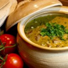 Mile High Green Chili - Green chili is a Colorado favorite. Roasting your veggies first gives this recipe a deeper level of flavor. This can be served over rice as a main course, stuffed in enchiladas, or over potatoes and eggs.