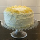 Sybil's Old Fashioned Lemon Layer Cake - Southern lemon cake is as well-loved a tradition as King cake; it's just not as well known. Enjoy 6 thin layers of light lemon cake filled and topped with tangy lemon filling.