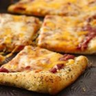 Italian Herb Crusted Cheese Pizza - Pizza crust seasoned with herbs and butter makes a delicious base for a cheese pizza.