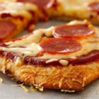 Parmesan Crusted Pepperoni Pizza - Butter and Parmesan cheese add to an already delicious crust for this pepperoni pizza!
