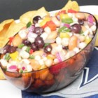 Tangy Cowboy Caviar - This cowboy caviar is loaded with corn, beans, and bell peppers and tossed in a simple marinade for a colorful salad topping or side dish.