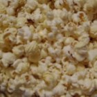 Bacon Popcorn - This is a flavorful popcorn treat that makes your mouth water and disappears fast! If you toss the cooked popcorn in a paper bag, it helps to absorb any extra grease, and keeps kernels from falling to the floor. The leftovers make nice snacks for lunch boxes.