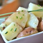 Boiled Potatoes with Chives - A simple recipe for springtime pairs little red potatoes with butter and chives for the most perfect side dish.