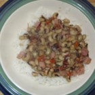 Southern-Style Crowder Peas - Delicious seasoned peas cooked with onions, peppers, bacon, and ham. A New Orleans style dish. Serve over rice.