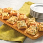 Spinach Artichoke Bread - French bread is hollowed out and filled with a creamy spinach and artichoke mixture, then sprinkled with mozzarella cheese and baked until bubbling in this quick and tasty appetizer.
