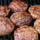 Chili Burgers - Sausage and chili sauce add to the usual ground beef to make a great consistency and flavor for burgers.
