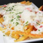 Creamed Hot Lobster Sandwich or Lobster Poutine - A creamed hot lobster sandwich is Nova Scotia comfort food at its best, or pour the creamed lobster over fries and mozzarella - lobster poutine!