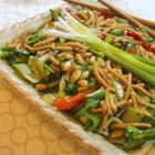 Asian Bok Choy Salad - Bok choy and green onions are topped with pine nuts and crunchy noodles, and served with a mildly sweet dressing.