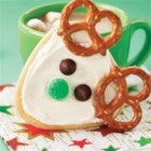 Frosted Reindeer Cookies - Just shape the cookie dough into a triangular log, and slice for fun reindeer cookies ready in a flash.