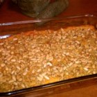 Butternut Squash and Pecan Casserole - Bubbling butternut squash casserole topped with a crunchy pecan topping is a great accompaniment to ham or turkey for holidays or potlucks.