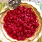 Summer Fresh Raspberry Pie - Sweet and fresh raspberries are topped with a quick raspberry sauce in this tempting summer dessert. Serve chilled with a dollop of whipped cream.