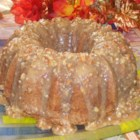 Jim's Apple Raisin Pound Cake with Praline Glaze - A rich, moist cake flavored with apples, raisins, allspice, and pecans gets a warm caramel glaze chock-full of more pecans.