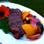Planked New York Strip Steak with Grilled Veggies - Grilling planks give a smoky flavor to these marinated steaks served with grilled zucchini, yellow squash, red potatoes, and other veggies.