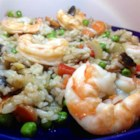 Ginger Shrimp with Fried Rice - Rice, shrimp, snow peas and corn are all fried together and served with a ginger sauce.