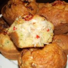 Crab-Stuffed Corn Muffins - Cornbread muffins are filled with crab and cheese for a savory party snack perfect for game day or any day.