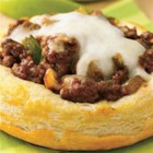 Sloppy Joe Biscuit Rounds - Make and bake individual bowls out of refrigerated buttermilk biscuits, then spoon in a meaty sauce for this hearty dish.