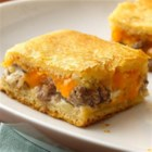 Sausage and Cheese Crescent Squares - Sausage and two kinds of cheese turn crescent dough into a rich and tasty appetizer.