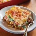 Thanksgiving Leftovers Casserole - This layered casserole with stuffing, turkey, veggies, mashed potatoes and cheese is the perfect way to serve Thanksgiving leftovers.