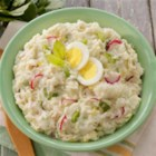Bea's Mashed Potato Salad - Bea's Mashed Potato Salad recipe puts a new spin on the seasonal favorite by starting with Idahoan Baby Reds(R) Flavored Mashed Potatoes.
