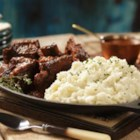 Braised Short Ribs with Roasted Garlic Horseradish Mashed - Beef short ribs are braised for hours with wine and vegetables in the oven until tender and flavorful, then served with horseradish mashed potatoes for a hearty meal perfect for cooler weather.