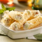 Mashed Potato Stuffed Cannoli - Cannoli gets a unique filling with this recipe for Mashed Potato Stuffed Cannoli. An appetizer sure to get your guests talking.