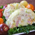 Kelly's Ham Jell-O(R) Salad - This different Jell-O(R) salad, made with cabbage, chopped ham, mayonnaise, and spicy brown mustard, has a taste that's more savory than sweet.