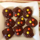 Chocolate Halloween Cookies - Rich chocolate cookies are loaded with candy-coated peanut butter pieces and topped with homemade chocolate frosting for a festive Halloween treat.