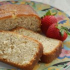 Lemon Bread - Lemon zest and nuts flavor this moist loaf that 's intensified with a lemon-sugar glaze.