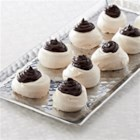 Black and Whites from Ghirardelli(R) - Light and elegant meringue cookies filled with dark chocolate ganache make a stylish addition to your cookie tray.