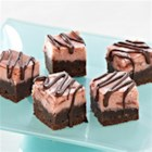 Black Bottom Cherry Cheesecake Bars - A creamy cherry cheesecake baked on a rich brownie layer is drizzled with chocolate for an elegant dessert.