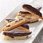 Chocolate, Orange, and Pistachio Biscotti - Crisp chocolate-dipped biscotti with chocolate chips, orange zest, and pistachios make great gifts or special treats to enjoy with a cup of coffee.