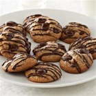 Cinnamon Chocolate Chip Cookies from Ghirardelli(R) - Loaded with cacao bittersweet chocolate chips, these cinnamon cookies drizzled with even more chocolate are perfect with coffee, tea, or a frosty glass of milk.